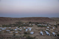 A general view of Umm Rakouba refugee camp which is currently hosting Tigray people who fled the conflict in Ethiopia's Tigray region, in Qadarif, eastern Sudan, Thursday, Nov. 26, 2020. Ethiopia's prime minister said Thursday the army has been ordered to move on the embattled Tigray regional capital after his 72-hour ultimatum ended for Tigray leaders to surrender, and he warned the city's half-million residents to stay indoors and disarm. (AP Photo/Nariman El-Mofty)