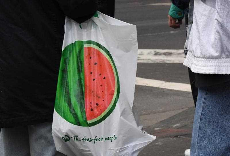 A shopper carries a reusable plastic bag at a Woolworths Sydney CBD store.