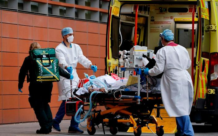 A patient being transferred to the Royal London Hospital - Tolga Akmen/AFP