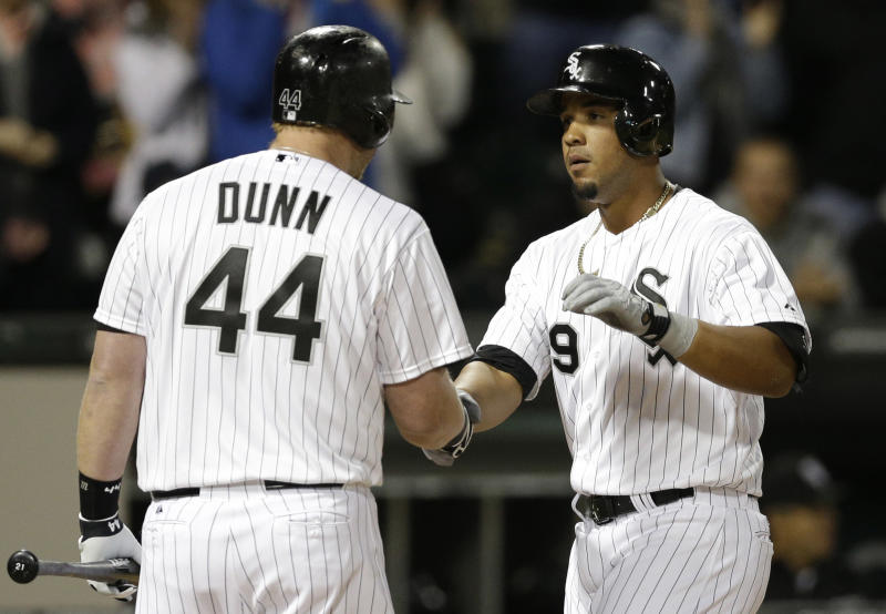Chicago White Sox's Jose Abreu, right, celebrates with Adam Dunn after hitting a solo home run during the second inning of a baseball game against the Cleveland Indians in Chicago, Thursday, April 10, 2014. (AP Photo/Nam Y. Huh)