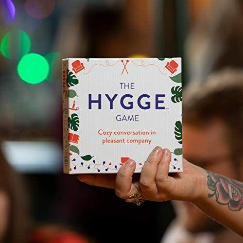 """<p><strong>Hygge Games</strong></p><p>amazon.com</p><p><strong>$20.00</strong></p><p><a href=""""https://www.amazon.com/dp/B0778X7GNL?tag=syn-yahoo-20&ascsubtag=%5Bartid%7C10057.g.28914935%5Bsrc%7Cyahoo-us"""" rel=""""nofollow noopener"""" target=""""_blank"""" data-ylk=""""slk:Shop Now"""" class=""""link rapid-noclick-resp"""">Shop Now</a></p><p>If your family likes to have long conversations by the fire, this set of cards is perfect for you. It's all about getting cozy with your loved ones and learning new things about each other, making your time together extra meaningful.</p>"""
