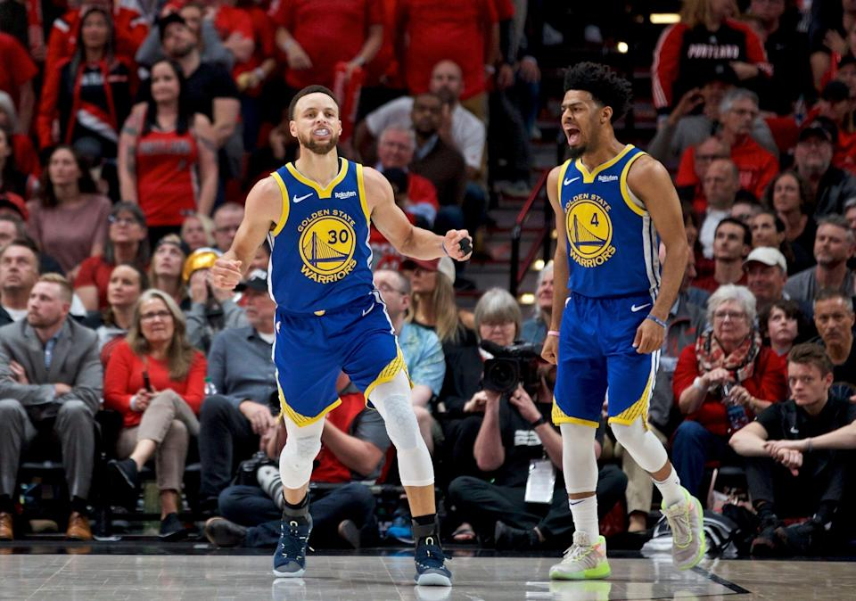 Golden State Warriors guard Stephen Curry, left, and guard Quinn Cook react after Curry made a basket against the Portland Trail Blazers during the second half of Game 4 of the NBA basketball playoffs Western Conference finals Monday, May 20, 2019, in Portland, Ore. The Warriors won 119-117 in overtime. (AP Photo/Craig Mitchelldyer)