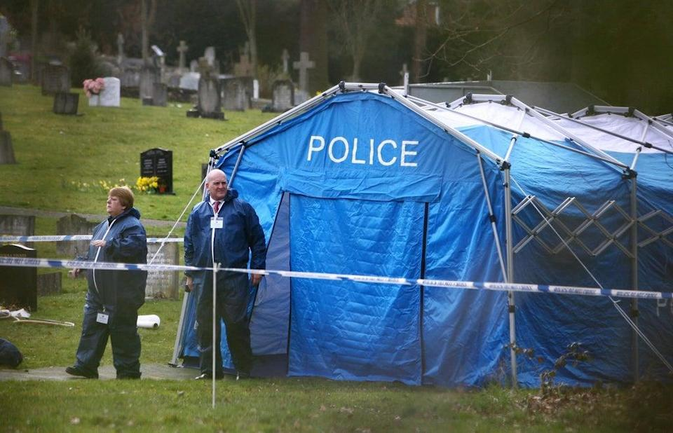 Forensics officers in Haywards Heath Cemetery in 2009, when the body of the unidentified man was exhumed by Sussex Police (Gareth Fuller/PA) (PA Archive)