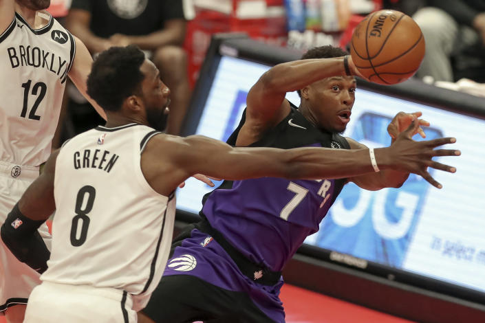 Toronto Raptors' Kyle Lowry (7) passes around Brooklyn Nets' Jeff Green during the second half of an NBA basketball game Wednesday, April 21, 2021, in Tampa, Fla. (AP Photo/Mike Carlson)