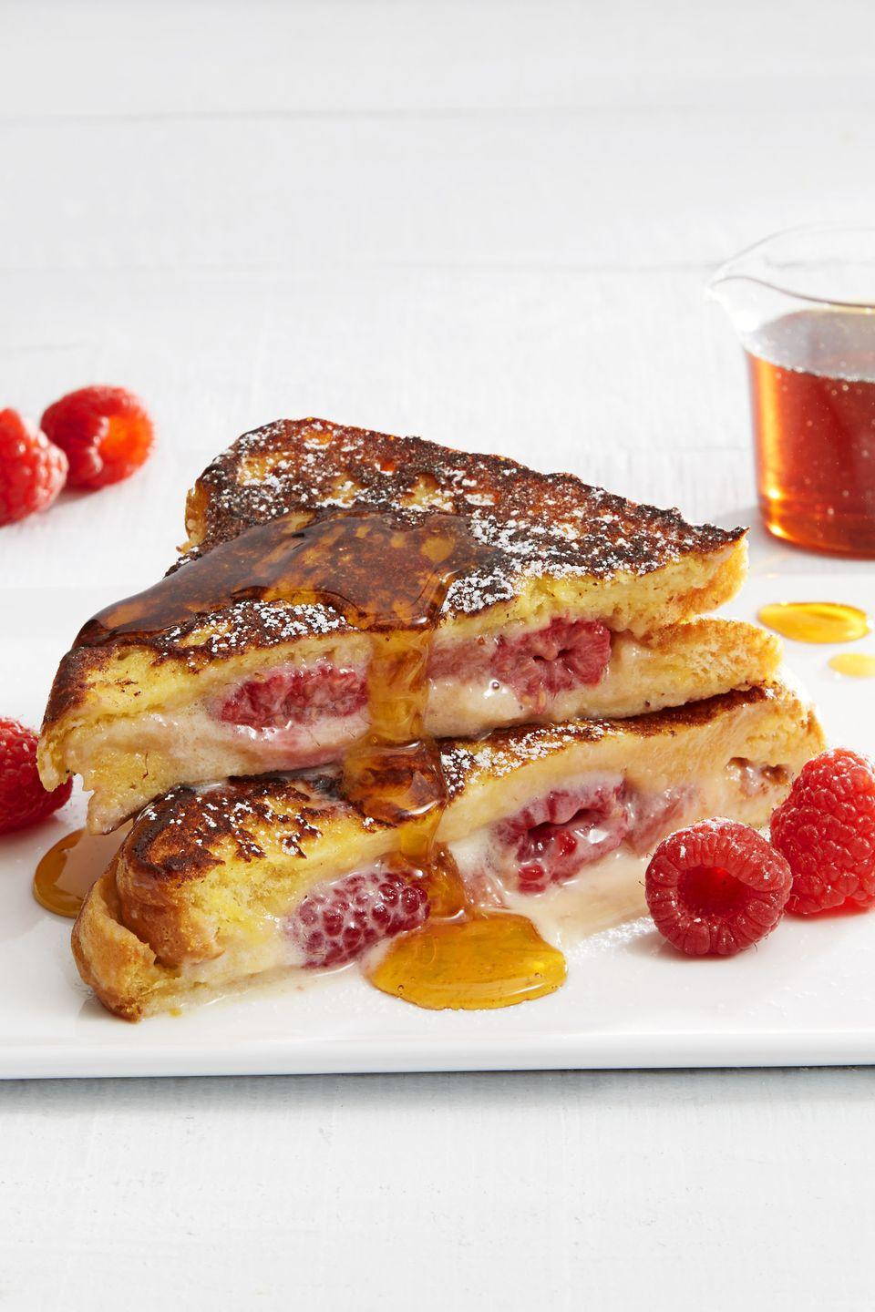 "<p>These raspberry-cheesecake sandwiches are every bit as delectable as they sound. </p><p><em><a href=""https://www.goodhousekeeping.com/food-recipes/a38409/raspberry-cheesecake-french-toast-recipe/"" rel=""nofollow noopener"" target=""_blank"" data-ylk=""slk:Get the recipe for Raspberry &quot;Cheesecake&quot; French Toast »"" class=""link rapid-noclick-resp"">Get the recipe for Raspberry ""Cheesecake"" French Toast » </a></em></p>"