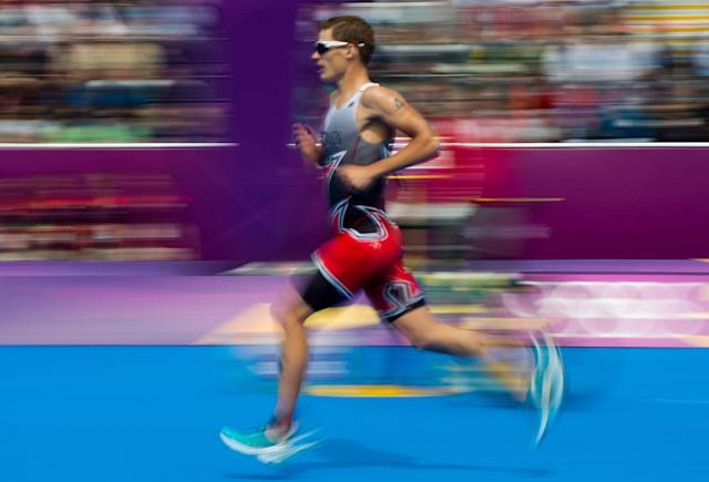 Canada's Brent McMahon runs as he races in the men's triathlon at Hyde Park during the Summer Olympics in London on Tuesday, August 7, 2012. THE CANADIAN PRESS/Sean Kilpatrick