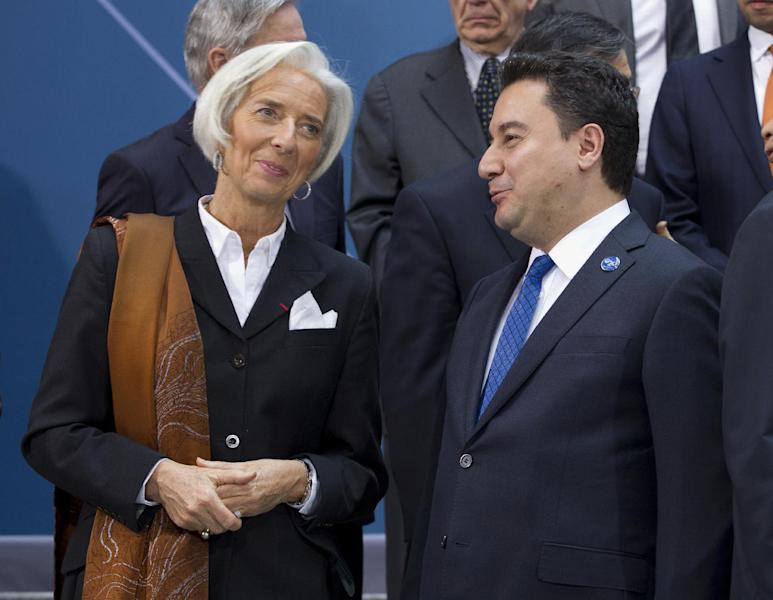 International Monetary Fund (IMF) Managing Director Christine Lagarde speaks with Turkish Deputy Prime Minister Ali Babacan, during the G-20 finance ministers and central bank governors group photo on the sidelines of their meeting at World Bank Group-International Monetary Fund Spring Meetings in Washington, Friday, April 11, 2014. ( AP Photo/Jose Luis Magana)