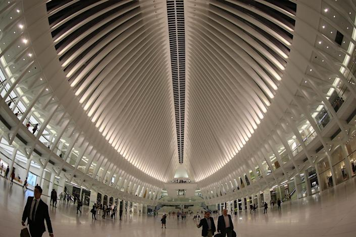 <p>People walk through the Oculus mall at World Trade Center on Wednesday, August 17, 2016. Over 100 stores and restaurants opened Tuesday at the Westfield World Trade Center at the Oculus. The 350,000 square-foot mall opened nearly 15 years after the Sept. 11 terrorist attacks at the World Trade Center in 2001. (Gordon Donovan/Yahoo News) </p>