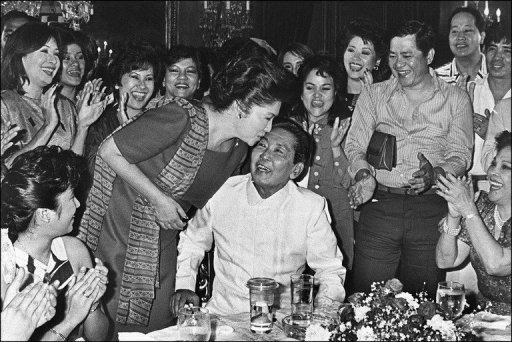 Late Philippines President Ferdinand Marcos (centre) receives a kiss from his wife Imelda (left), after his victory in the 1986 presidential elections. The Philippine government has auctioned off a prime property once owned by the late dictator for more than $2 million