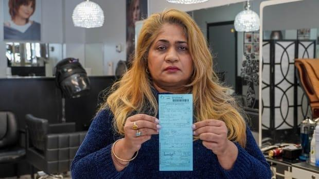 Sunita Robertson, owner of Soni Hair Design, says she only entered her salon to do some painting and upkeep when a bylaw officer ticketed her for opening during the provincewide shutdown. (Jean Delisle/CBC - image credit)