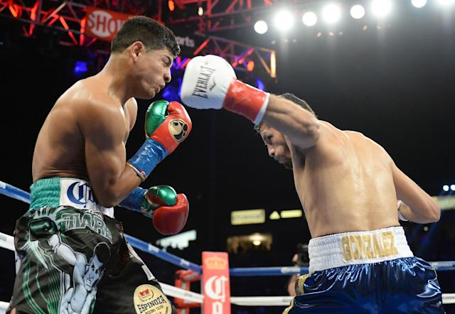 CARSON, CA - AUGUST 24: Abner Mares is knocked down by Jhonny Gonzalez during the WBC Featherweight Title Fight at the StubHub Center on August 24, 2013 in Carson, California. Gonzalez would win in a first round konckout. (Photo by Harry How/Getty Images)