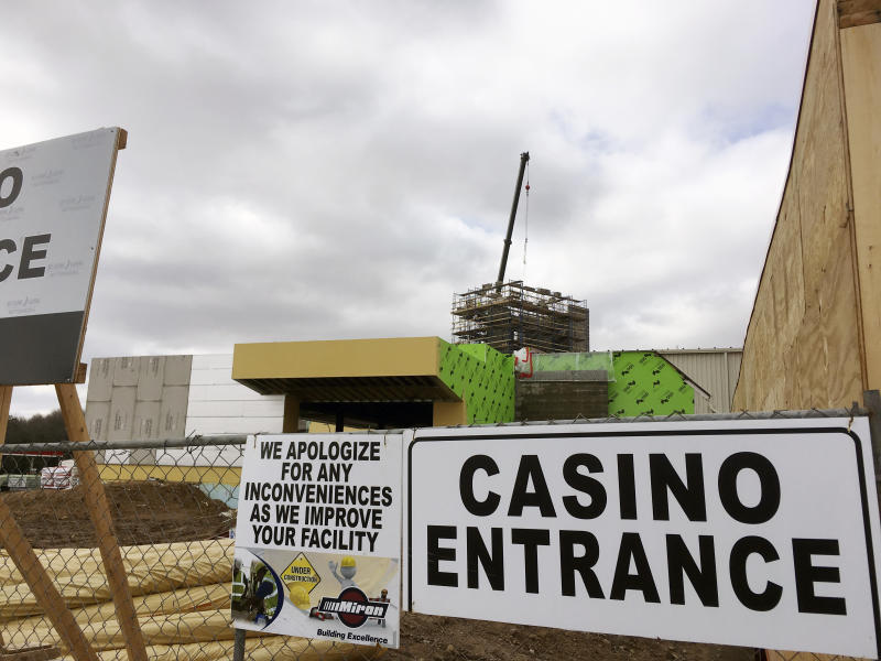 In this April 13, 2017, photo, a crane towers over construction work at the Ho-Chunk Nation's casino in Wittenberg, Wis. The Ho-Chunk is adding a hotel and a restaurant to the site, stoking fears from rival Stockbridge-Munsee Band of Mohicans that the expanded facility will hurt business at that tribe's nearby North Star casino. (AP Photo/Todd Richmond)
