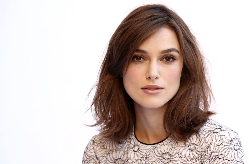 """In this Tuesday, Nov. 13, 2012 photo, actress Keira Knightley, from the film """"Anna Karenina,"""" poses for a portrait in Los Angeles. Director Joe Wright gives the costume drama a modern spirit and the result is a fluid story that unfolds as much like dance as film, with a brisk pace compared to most period stories and contemporary sensibilities next to earlier takes on """"Anna Karenina,"""" whose previous big-screen adaptations have featured Greta Garbo and Vivien Leigh. (Photo by Matt Sayles/Invision/AP)"""