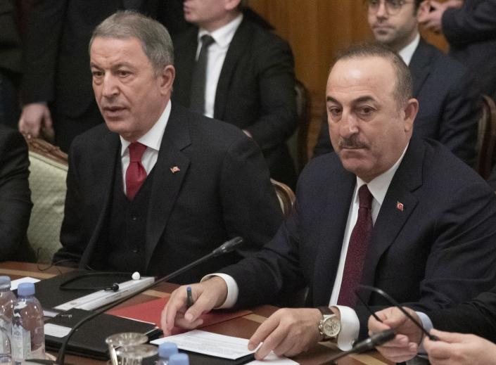 Turkish Foreign Minister Mevlut Cavusoglu, right, and Turkish Defense Minister Hulusi Akar attend talks with Russian Foreign Minister Sergey Lavrov and Russian Defense Minister Sergei Shoigu in Moscow, Russia, Monday, Jan. 13, 2020. Foreign and defense ministers of Russia and Turkey met as part of an effort by Moscow and Ankara to sponsor Monday's talks between rival parties in Libya in the Russian capital. (AP Photo/Pavel Golovkin, Pool)