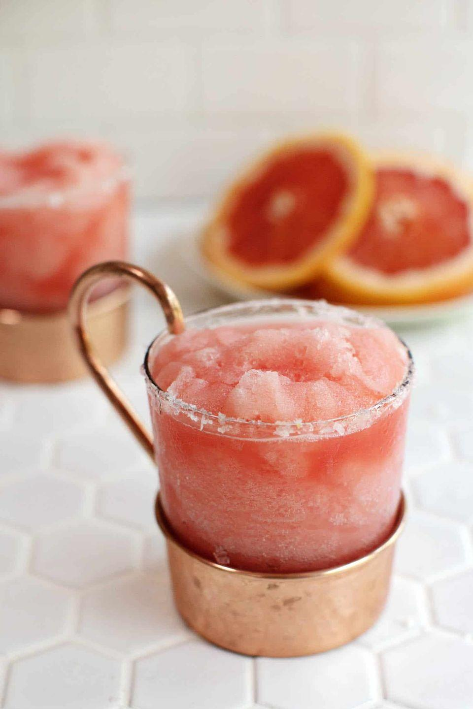 """<p>Try this frozen concoction that's made with gin or vodka—and only two other ingredients—for a delightful sip.</p><p><strong>Get the recipe at <a href=""""https://abeautifulmess.com/2018/05/frozen-sweet-and-salty-dog.html"""" rel=""""nofollow noopener"""" target=""""_blank"""" data-ylk=""""slk:A Beautiful Mess"""" class=""""link rapid-noclick-resp"""">A Beautiful Mess</a>.</strong></p><p><strong><a class=""""link rapid-noclick-resp"""" href=""""https://www.amazon.com/Hamilton-Beach-Functions-Dishwasher-58148A/dp/B00EI7DPI0/?tag=syn-yahoo-20&ascsubtag=%5Bartid%7C10050.g.30433150%5Bsrc%7Cyahoo-us"""" rel=""""nofollow noopener"""" target=""""_blank"""" data-ylk=""""slk:SHOP BLENDERS"""">SHOP BLENDERS</a><br></strong></p>"""