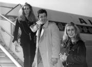 FILE - In this Nov. 29, 1968 file photo, actress Ursula Andress, left, joins Jean-Paul Belmondo, center, and Catherine Deneuve, right, on the gangway of the plane in Orly airport, France. French New Wave actor Jean-Paul Belmondo has died, according to his lawyer's office on Monday Sept. 6, 2021. (AP Photo/File)