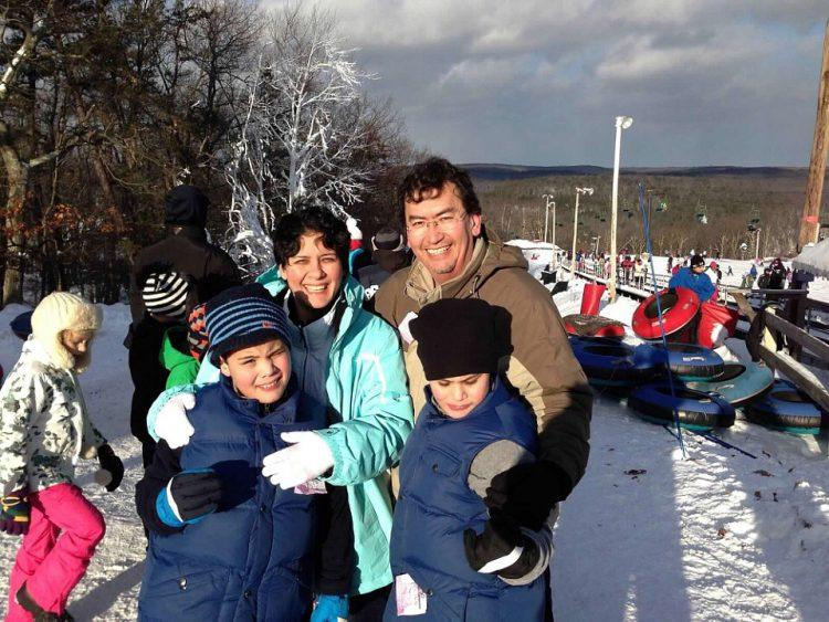 Family picture: mom dad and twin boys at a ski resort