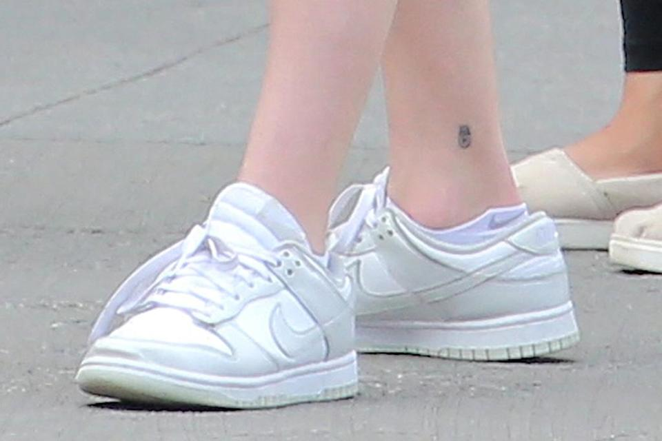 A closer view of Sophie Turner's sneakers. - Credit: Splash News