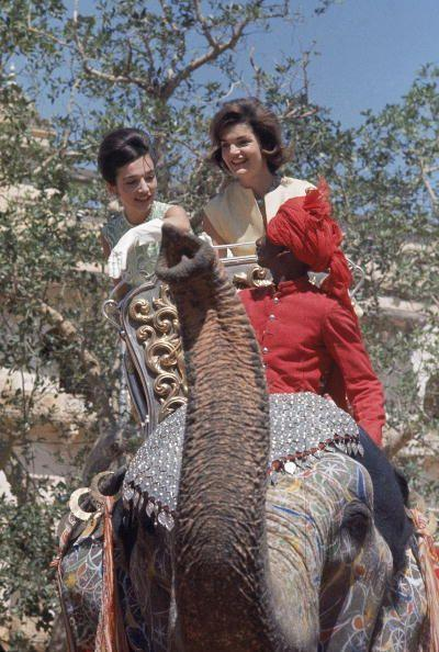 <p>First Lady Jacqueline Kennedy and her younger sister Lee Radziwill shown riding an elephant while on a trip to India.</p>