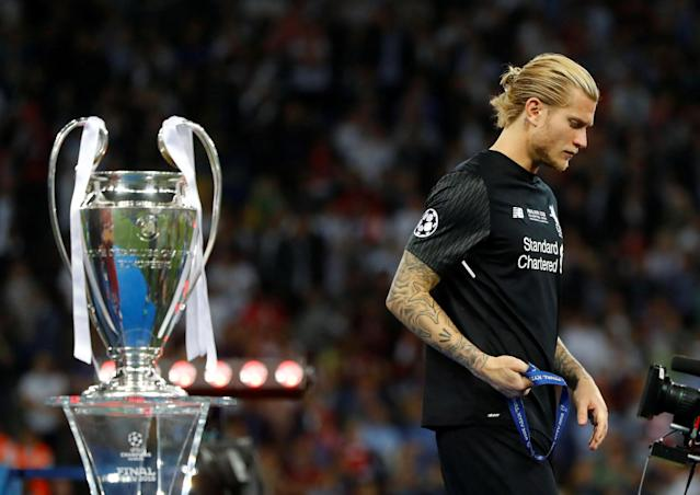 Soccer Football - Champions League Final - Real Madrid v Liverpool - NSC Olympic Stadium, Kiev, Ukraine - May 26, 2018 Liverpool's Loris Karius walks past the trophy with his medal after the match REUTERS/Kai Pfaffenbach TPX IMAGES OF THE DAY