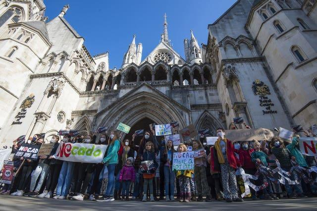 Children from Yerbury Primary School in Islington, north London, take part in a protest outside the High Court in May