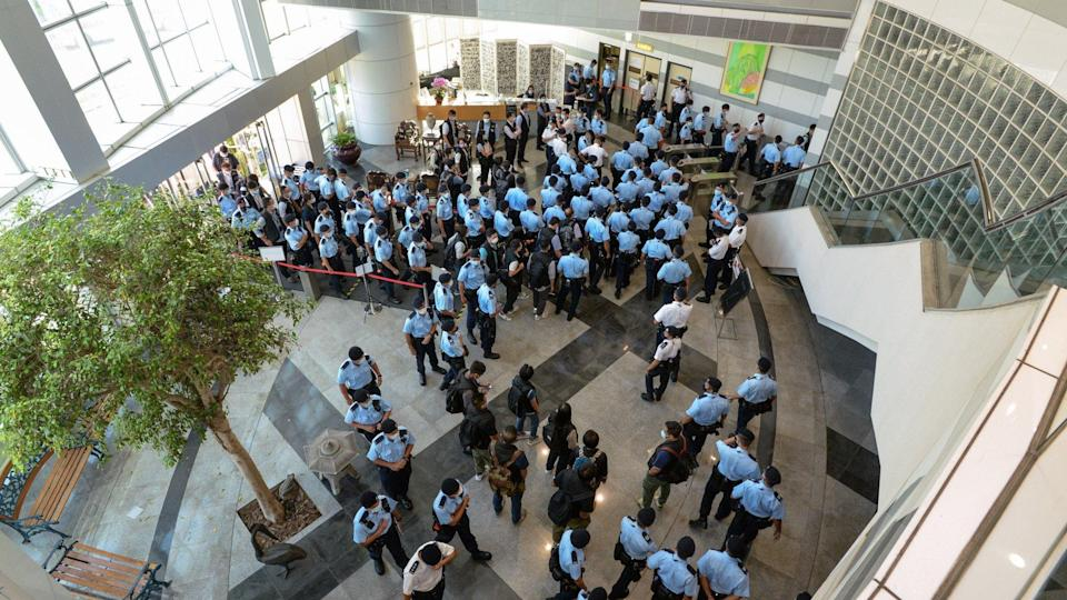 Hong Kong national security police fill the lobby of the Apple Daily offices on Thursday morning. Photo: Handout