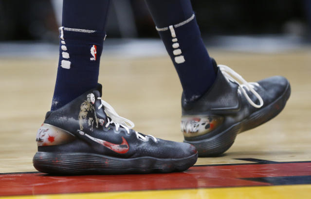 "<a class=""link rapid-noclick-resp"" href=""/nba/players/5432/"" data-ylk=""slk:Karl-Anthony Towns"">Karl-Anthony Towns</a> wore ""Friday the 13th""-inspired sneakers, complete with Jason Voorhees wielding a Swoosh. (AP)"