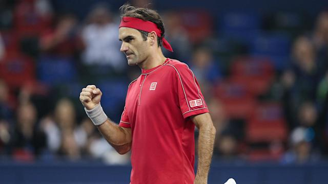 Andy Murray suffered defeat in an ill-tempered match with Fabio Fognini. Roger Federer, in contrast, eased through in Shanghai.