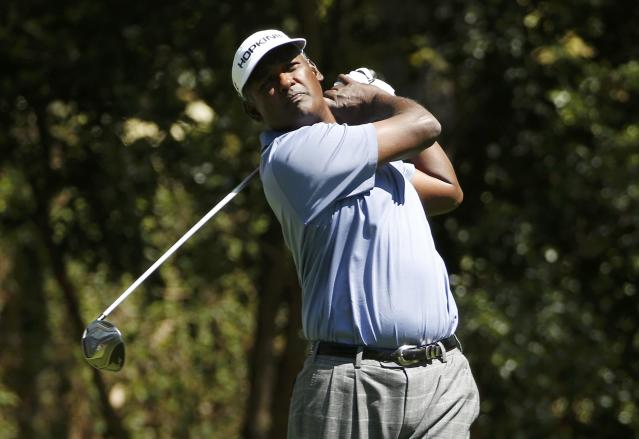 Former Masters champion Vijay Singh of Fiji tees off on the second hole during the first round of the 2014 Masters golf tournament at the Augusta National Golf Club in Augusta, Georgia April 10, 2014. REUTERS/Jim Young (UNITED STATES - Tags: SPORT GOLF)