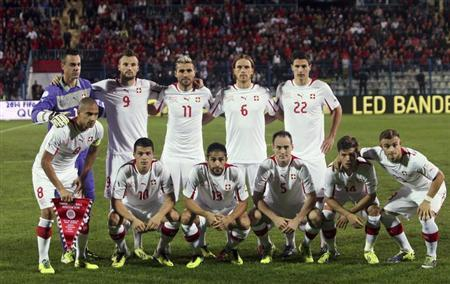 Switzerland's team poses for the media before their 2014 World Cup qualifying football match against Albania at Qemal Stafa stadium in Tirana October 11, 2013. REUTERS/Arben Celi