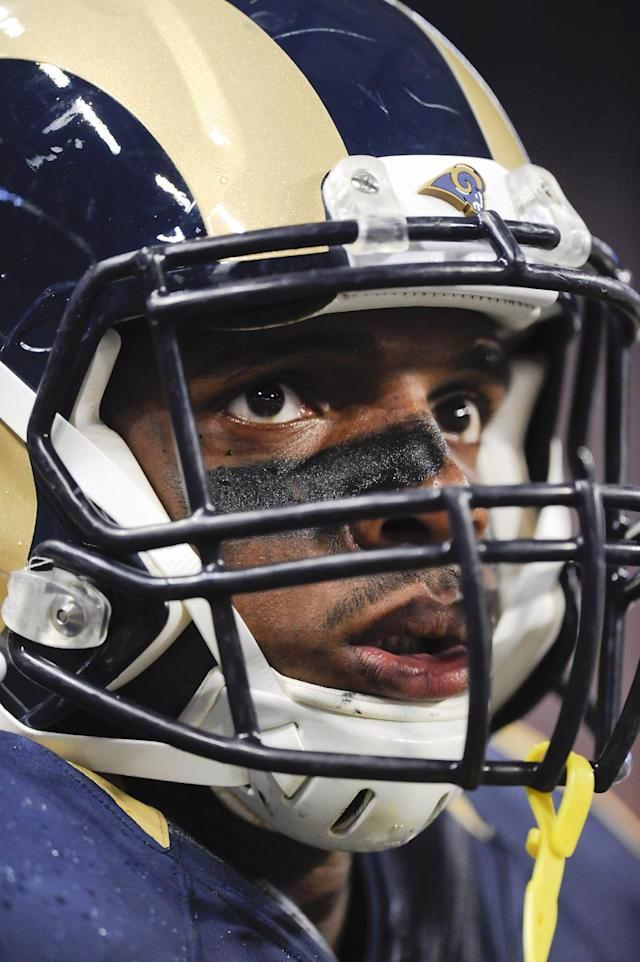 St. Louis Rams defensive end Michael Sam looks up at the scoreboard in the first quarter of a preseason NFL football game between the Rams and the New Orleans Saints on Friday, Aug. 8, 2014, in St. Louis. (AP Photo/L.G. Patterson)