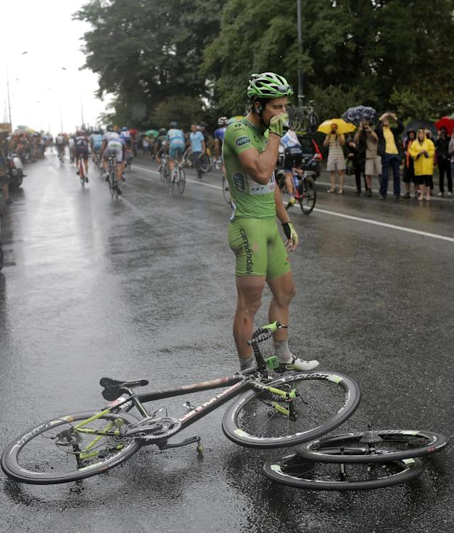 Peter Sagan of Slovakia, wearing the best sprinter's green jersey, waits for assistance after crashing in the last three kilometers of the nineteenth stage of the Tour de France cycling race over 208.5 kilometers (129.6 miles) with start in Maubourguet and finish in Bergerac, France, Friday, July 25, 2014. (AP Photo/Laurent Cipriani)