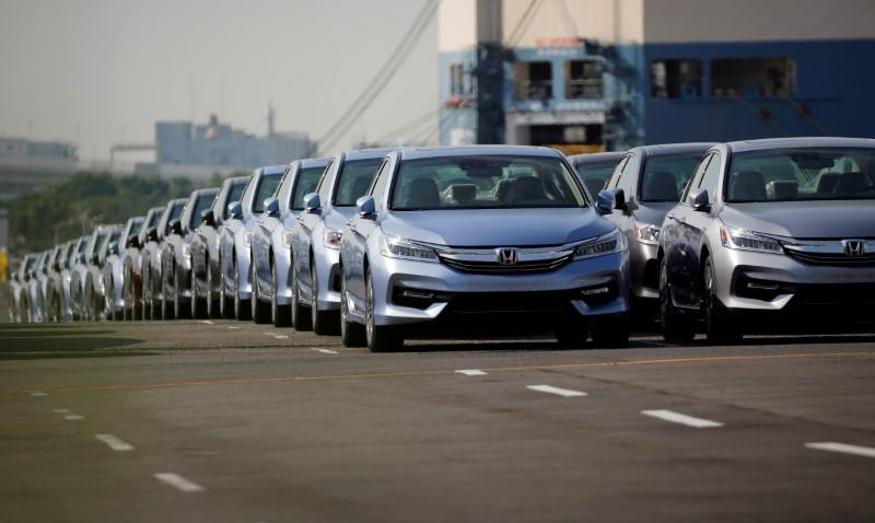 FILE PHOTO: Newly manufactured cars of the automobile maker Honda await export in a port in Yokohama