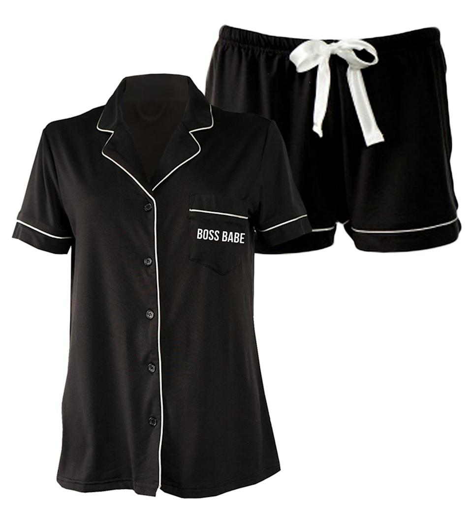 """<p>Let everyone in your house know who the """"Boss Babe,"""" """"Queen Bee,"""" or """"Bad Ass Mama"""" is with these cute, comfy pajamas.</p> <p><strong>$72, <a href=""""https://losangelestradingco.com/products/short-set-boss-babe"""" rel=""""nofollow noopener"""" target=""""_blank"""" data-ylk=""""slk:losangelestradingco.com"""" class=""""link rapid-noclick-resp"""">losangelestradingco.com</a></strong></p> <p><strong>*Use discount code EWLOVE25 for 25% off</strong></p>"""