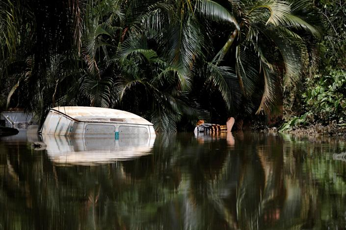 A car submerged in flood waters is seen close to the dam of the Guajataca lake after the area was hit by Hurricane Maria in Guajataca, Puerto Rico September 23, 2017. REUTERS/Carlos Garcia Rawlins TPX IMAGES OF THE DAY