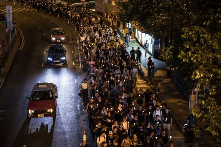 People attend a candlelight march for the late Chinese Nobel laureate Liu Xiaobo in Hong Kong on July 15, 2017