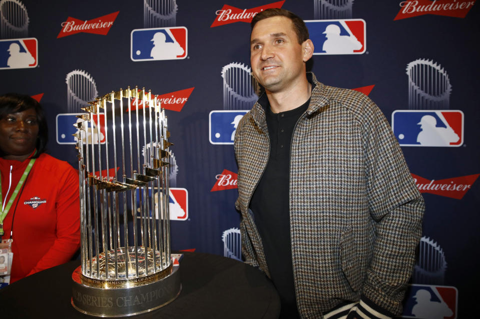 Washington Nationals first baseman Ryan Zimmerman poses with the World Series trophy as he arrives for the premiere of a documentary film on the team's first World Series baseball championship, Monday, Dec. 2, 2019, in Washington. (AP Photo/Patrick Semansky)