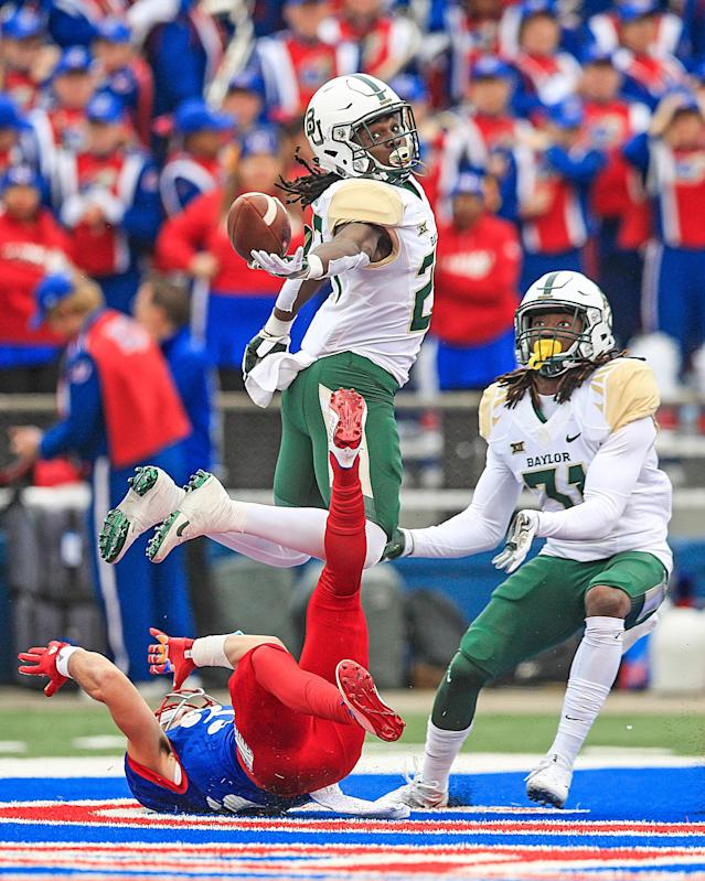 <p>Cornerback Verkedric Vaughns #27 of the Baylor Bears attemptes to intercept the ball against the Kansas Jayhawks during the first half at Memorial Stadium on November 4, 2017 in Lawrence, Kansas. (Photo by Brian Davidson/Getty Images) </p>