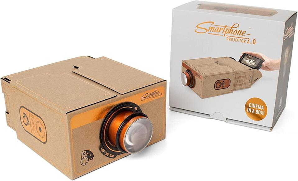 <p>Take watching movies on your phone to a whole new level with this <span>Smartphone Projector 2.0</span> ($30).</p>