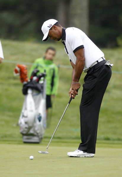 Tiger Woods putts on the 11th green during the pro-am round of the Deutsche Bank Championships in Norton, Mass., Thursday, Aug. 29, 2013. (AP Photo/Stew Milne)