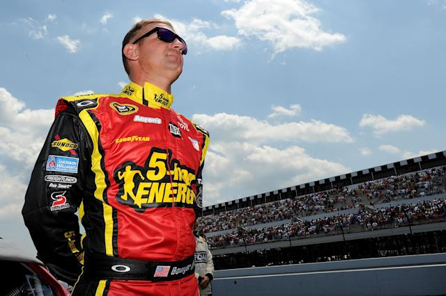 LONG POND, PA - JUNE 10: Clint Bowyer, driver of the #15 5-hour Energy Toyota, stands on the grid before the start of the the NASCAR Sprint Cup Series Pocono 400 presented by #NASCAR at Pocono Raceway on June 10, 2012 in Long Pond, Pennsylvania. (Photo by Drew Hallowell/Getty Images)