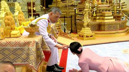 King Maha Vajiralongkorn and his consort, General Suthida Vajiralongkorn named Queen Suthida, attend their wedding ceremony in Bangkok, Thailand May 1, 2019, in this screen grab taken from a video. Thai TV Pool