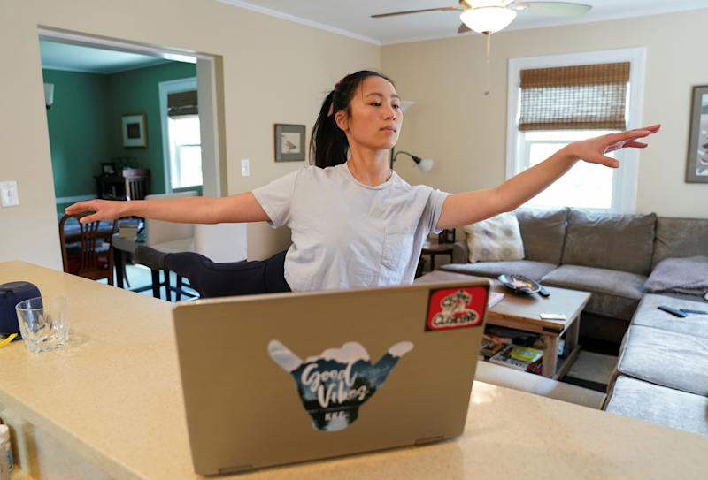 Due to the coronavirus disease (COVID-19) outbreak, Allison Vernon, a ballet major at the University of Utah, continues her dance curriculum online from her laptop in a makeshift studio at her home in Arlington,Virginia, U.S., April 17, 2020. REUTERS/Kevin Lamarque