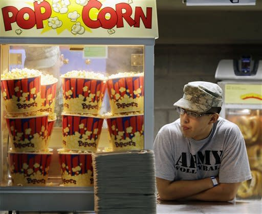 Cadet Steven Liu of San Marino, Calif., waits for customers while working at a concession stand before an NCAA college football game between Army and Boston College on Saturday, Oct. 6, 2012, at Michie stadium in West Point, N.Y. (AP Photo/Mike Groll)
