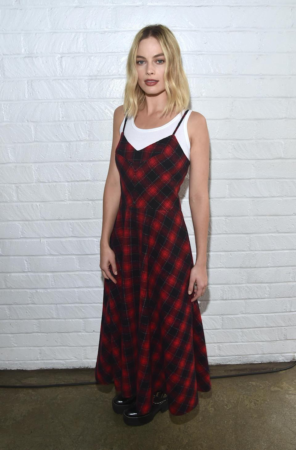 <p>Robbie looked very '90s in a plaid slip dress with a white T-shirt underneath. (Photo: Getty Images) </p>