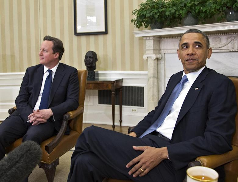 President Barack Obama welcomes British Prime Minister David Cameron in the Oval Office of the White House in Washington, Monday, May 13, 2013, for talks on subjects ranging from Syria's civil war to preparations for a coming summit of the world's leading industrial nations in Northern Ireland. (AP Photo/J. Scott Applewhite)