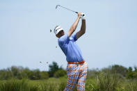 Ian Poulter, of England, hits off the fifth tee during the third round at the PGA Championship golf tournament on the Ocean Course, Saturday, May 22, 2021, in Kiawah Island, S.C. (AP Photo/Matt York)