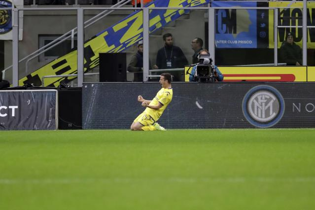 Verona's Valerio Verre celebrates after scoring his side's opening goal during the Serie A soccer match between Inter Milan and Hellas Verona, at the San Siro stadium in Milan, Italy, Saturday, Nov. 9, 2019. (AP Photo/Luca Bruno)