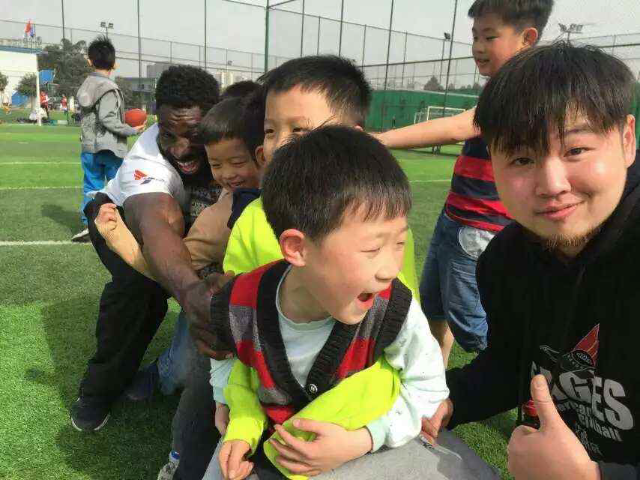 Wendell Brown, back, spent time in China teaching the game of football to kids before he was jailed for his involvement in a bar fight. (Courtesy of the Brown family)
