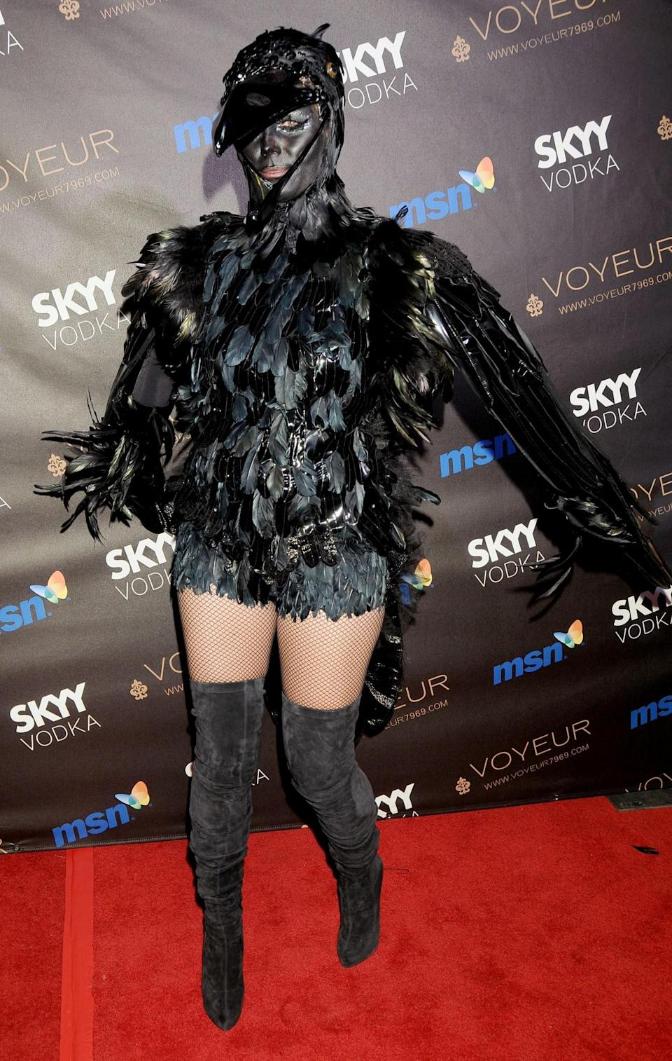 <p>In 2009, Klum gave us that most spooky (and most annoying) member of the avian world, the crow. (Photo: Getty Images) </p>